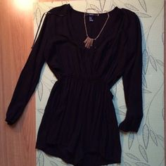 Black romper Black long sleeve romper with cut out sides. Super cute! Worn twice Dresses