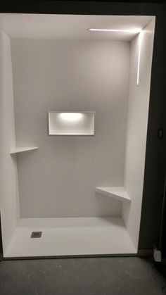 Our Solid Surface Shower base and wall system with a built in niche, complete with waterproof low voltage, dimmable led lights. Totally waterproof, very easy clean surface, modern design, available in over 50 colours and designs