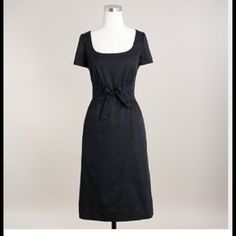 """J. Crew Cotton Poplin Tie-Front Dress A chic little shift dress in crisp cotton poplin. It has a flattering fitted bodice, gathered skirt, and is finished with a sweet bow at center-front waist. Scoopneck at front and back. Short sleeves. Inset waistband. Side-seam pockets. Side zip. Bodice is lined. Falls above knee; 22"""" from natural waist. Size: 4. Color: Black. J. Crew Dresses"""