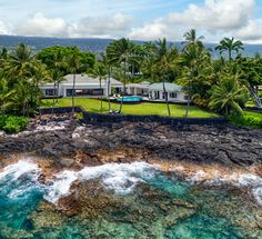This beautiful luxurious oceanfront residence is comprised of over an acre of tropical lush landscape within the private gated community called, Alii Point. It includes 5 bedrooms, an office, and 6.5 baths. With approximately 190 feet of prime ocean frontage on the Kona Coast near the well-known surf break called Riviera's, and the white sandy beaches along Alii Drive make the most out of the warm, breezy climate.