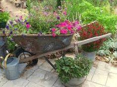 Image result for wheelbarrow planter ideas