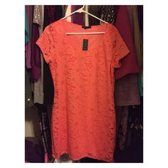 Women's pink/coral/peach dress NWT Women's pink/coral/peach dress NWT. Beautiful form fitting dress. Size L. Cute fire this spring or Easter dress  Dresses Midi