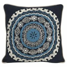 "Cotton pillow with an embroidered medallion motif.  Product: PillowConstruction Material: Cotton cover and polyester fillColor: Ivory, black, and blueFeatures: Insert includedDimensions: 16"" x 16"""