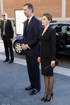 Queen Letizia cut a sombre figure today as she and her husband King Filipe VI of Spain att...