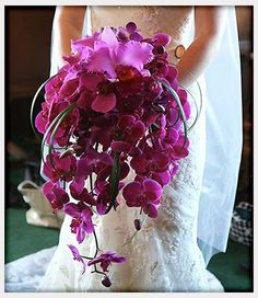 Stunning phalaenopsis orchid and grass bridal bouquet #radiantorchid #magentabouquet