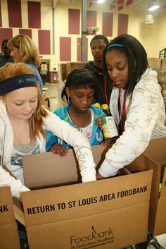 Students from Holman Middle School in the Pattonville School District volunteer at the St. Louis Area Foodbank in January. The students sorted and repackaged food for people in need as part of school-wide community service project. The students are participating in Rachel's Challenge, a program inspired by Rachel Scott, the first victim of the Columbine High School shootings. The program teaches students about compassion and treating others with kindness. #kids #Columbine #volunteer