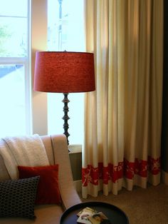 Add a decorative band of fabric to ready-made drapes for a custom look.
