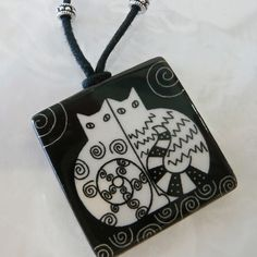 The Magical Animal - VIRGINIA MISKA CERAMIC JEWELRY Side-by- Side Cat Necklace, $30.00 (http://www.themagicalanimal.net/products/virginia-miska-ceramic-jewelry-side-by-side-cat-necklace.html)