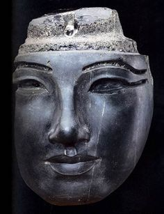 Face from a Royal Composite Statue Obsidian Height 19.5 cm (7.7 in); width 14.2 cm (5.6 in) 18th Dynasty; reign of Amenhotep III Karnak, Precinct of Amun Court of the Cachette CG 42101