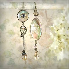 Daybreak Asymmetrical Earrings - Mermaid Jewelry - Beach Wedding - Unique Ivory Cream Seashell Earrings - Petite Length - Boho Bride. $49.00, via Etsy.
