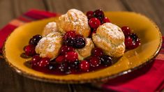 Narcoossee's in Disney's Grand Floridian Resort & Spa, these pumpkin profiteroles have a pumpkin cream puff filling and are topped off with cranberry-blueberry sauce.