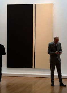 "Barnett Newman's ""Black Fire I"", painted in 1961, on display during a preview of the Impressionist and Modern Art sale at Christie's in New York. The work fetched $84.2 million in New York in May, 2014, a record for the artist. Photographer: Stan Honda/AFP via Getty Images"