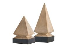These solid mango wood pyramid sculptures have been lightly finished in a natural white wash to contrast with the oxidized iron-clad sheet applied around the base. We love a single size lined down the center of a table or going up the stairs as much as we like them paired together. finish:mango wood, natural white...
