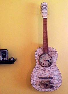 Time steam punk acoustic guitar clock art piece- reuses antique clock parts, sheet music of songs with time in the title and lyrics and the clock works. Cool functioning art that repurposes a spent acoustic vintage guitar!