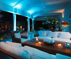 What would a luxurious outdoor celebration in Barbados be without a chic, white lounge area and candlelight?