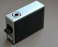 Room 606 — A black Oxford leather and chrome TFG 1 Permanent Table Lighter by Reinhold Weiss for Braun, 1965