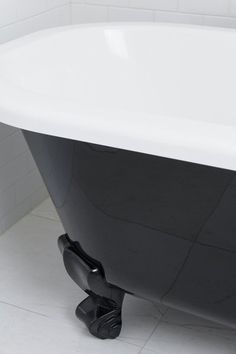 Browse our beautiful bathroom designs for inspiration. This dramatic black & white bathroom exudes opulence. Perrin & Rowe tapware combines with Victoria+Albert bath for a match made in heaven. Black White Bathrooms, Bathtub, English, Black And White, Inspiration, Home, Ideas, Design, Standing Bath