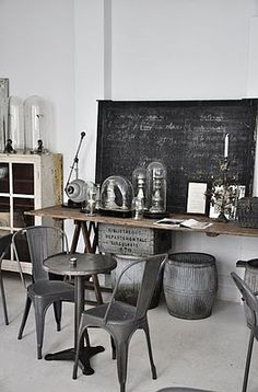#Industrialchic There's just something cool about raw metal finish on industrial furnishings. The bell jars are a nice accent on the table