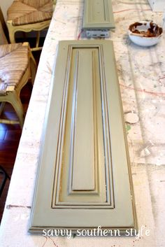 Savvy Southern Style: Kitchen Cabinets Tutorial - used chalk paint, glaze and a sealant from Annie Sloan - not interested in the chalk paint but the rest is interesting