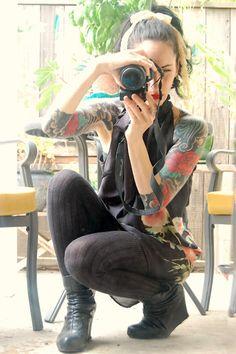 Red floral tattoo work on Catherine Masi by tattoo artist Sebastian Orth