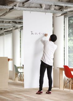Not sure how this works but it could be a cool solution for adding spontaneos white board space throughout the office