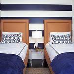 boy's rooms - white Jonathan Adler lamp horizontal striped white blue walls orange twin beds nailhead trim seagrass rug blue bedding pillows boy's room Acrylic Nesting Tables Giraffe Lamp