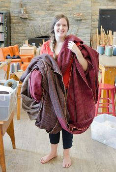 Student Amy Trosmiczak with the 14 yards of tweed she made in the spring weaving class at Penland School of Crafts.