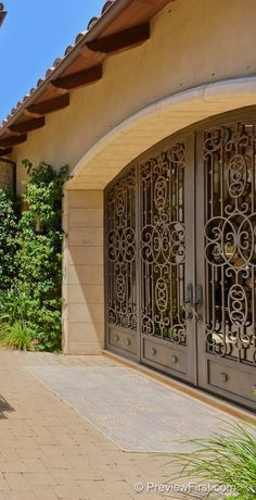 Wrought-Iron doors have never really caught on in the Charlotte area, but occasionally you can see a brave homeowner with a distinctive taste.