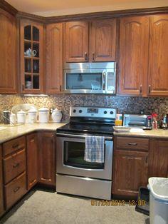 ah ha! My exact color cabinet! American woodmark oak tawny