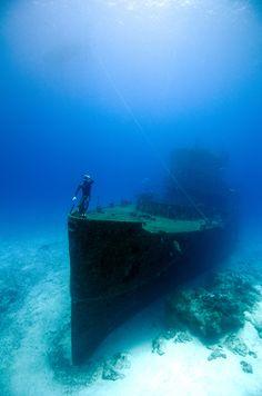 Freediving the Felipe Xicoténcatl C-53 Shipwreck off Cozumel Island, Mexico. Photo taken on one breath by Christina Saenz de Santamaria.