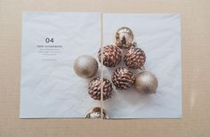 1 lrg photo across 2pg spread - likey. Also scrumpled flattened tissue paper behind ornaments