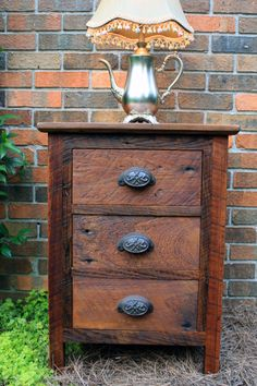 So cool!  Bedside Table with Drawers, Reclaimed Wood, Dark Honey Brown Finish - Handmade. $550.00, via Etsy.