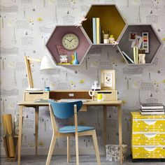 Retro home office with statement wallpaper and hexagonal wall shelves