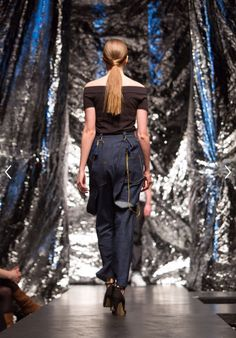 Jeans with tassle and chain detail. Oversized, twisted seams. High shine. Inspired by 1900s denim for feminism. By Glasgow School of Art Fashion Student Aymie Black.