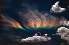The fire rainbow is the rarest of all naturally occurring phenomena. The clouds must be cirrus and at an altitude of 20,000 feet at least. There must be just the right amount of ice crystals present, as well.     The sun has to hit the clouds at exactly 58 degrees. It makes the rainbow appear to be on fire, hence the name. It's actually cold as ice, though. In the weather world, the phenomena is known as a circumhorizontal arc.