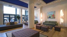 A suitably chic lobby lounge serves coffee and relaxing time after a long day in Athens' s interesting sites. Greece Hotels, Lobby Lounge, Acropolis, Athens Greece, Best Sites, Rooftop, Patio, Windows, Traditional