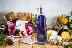 Mirari Blue Gin and Tonic, served with a delectable cheese platter. Fill a highball glass up to the top with ice cubes. Top with a premium Indian Tonic Water. Garnish with plums and purple basil. Tonic Water, Gin And Tonic, Blue Gin, Highball Glass, Cheese Platters, Ice Cubes, Distillery, Basil, Plum