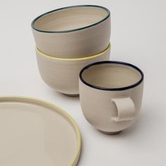 This mug is handmade with beautiful proportions. The stoneware clay is hand-thrown and smoothed before fully dry, decorated with a tinted slip clay on the rim, and then finished with a transparent glaze on the inside and rim. The flat formed sturdy handle compliments the shape perfectly. With the exterior left unglazed, giving it a wonderfully tactile quality that is a joy to hold. Textures And Tones, Stoneware Mugs, Espresso Cups, Natural Texture, Compliments, Glaze, Handle, Joy, Exterior