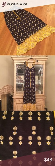 """Juicy could tour maxi sundress size M This is a very nice Maxi Sundress by juicy could tour drawstring elastic under the bus ruffled on the bottom colors like navy blue floral yellow and white print yellow blue and white background on yellow measurements are 32 across the bust see pics for other bust measurements Length of dress is 57"""" Juicy could tour Dresses Maxi"""