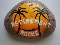 Painted rock with RETIREMENT ROCKS message. Relaxing tropical sunset picture with palm trees and hammock. Great fun gift for a relative or co-worker.
