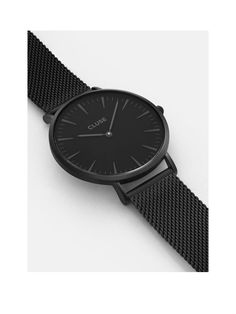 The Cluse La Bohème all black mesh bracelet ladies watch is modern and chic A true standout style piece, this black watch looks modern and elegant while still remaining unmistakeably feminine. The black bezel and mesh bracelet design are sophisticated for a look that will give any outfit a superb modern lift. The face features a matching colour scheme with minimalist facial features such as time batons, hands and Cluse branding. It's water resistant to 30 metres so you can take it to the...