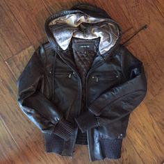 Leather bomber style jacket with hood Buttery soft, chocolate brown leather bomber style jacket with soft faux fur lined hood. Worn max of 3 times. EUC with no signs of wear. Great detailing with zippered pockets and drawstring around hood. Inside is quilted and super warm! Perfect fall leather jacket. Really unique style! Size L but on the snug side of a large. Jones New York Jackets & Coats