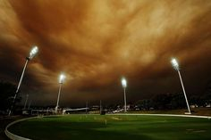 A general view of play during the Ryobi Cup cricket match between the South Australian Redbacks and the Western Australia Warriors at Drummoyne Oval on October 17, 2013 in Sydney, Australia. Sydney is shrouded in a haze of smoke as brushfires rage in the western Sydney suburbs of Springwood, Winmalee and Lithgow. (Mark Metcalfe - Getty Images)