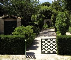 From: Garden Details by Thornell...love the garden gate.