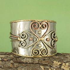 @Overstock - Add design and flair to your everyday style with this handcrafted copper and brass metal bracelet from India. Cuff features textured silvertone metal with copper and brass hearts forming a cross design.http://www.overstock.com/Worldstock-Fair-Trade/Handcrafted-Hammered-Brass-Copper-Cross-Cuff-Bracelet-India/7327187/product.html?CID=214117 $30.99