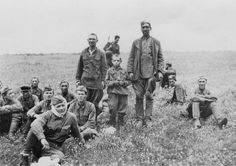 Russian POWs, including a child soldier, are guarded by a single German, summer 1942.