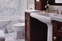 I like the pedestal sink with cabinets on the side for storage and counter space.