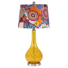 Glass table lamp in amber with a floral-print drum shade.  Product: Table lampConstruction Material: Glass and fabric...