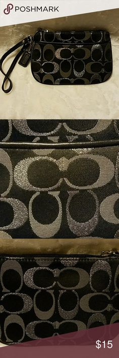Coach Black With Grey And Metallic Silver Wristlet Coach, wristlet in the traditional C and fabric colors of black, grey, silver metallic. With the pull and brand tag, silver hardware. This one has a nice outside pocket for keys or phone. Please note last picture: the inside, unseen, liner has a spot on it. NO wear or tear on remaining bag. Cleaning out my personal closet. Coach Bags Clutches & Wristlets