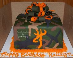 "3 layer, 8"" fondant cake with fondant camo pattern cut free handed. Bow was hand made out of fondant. TFL!"